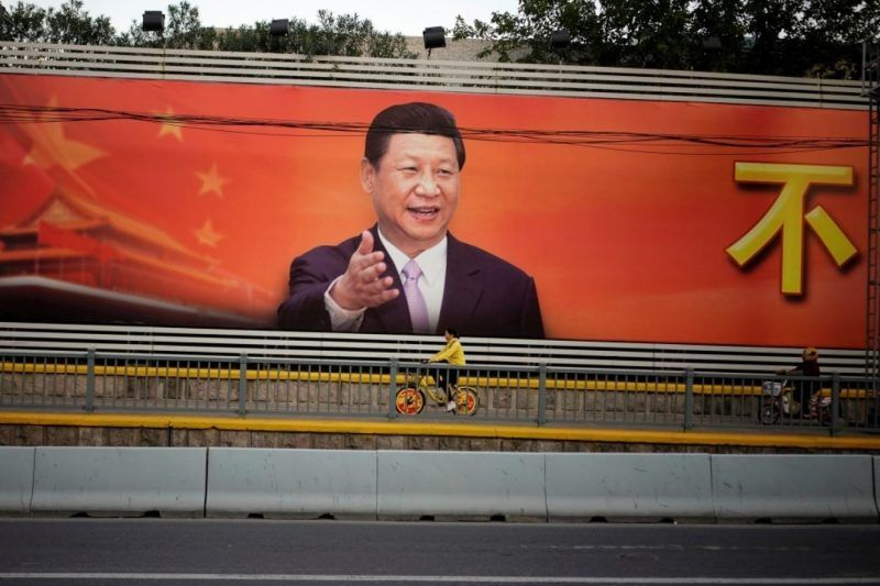 A poster with a portrait of Chinese President Xi Jinping is displayed along a street in Shanghai on Tuesday. (Reuters)
