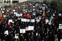 Protesters rally in Tehran on Saturday. (Ebrahim Noroozi/Associated Press)