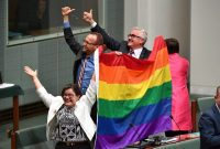 Members of the Australian Parliament celebrate the passing of a same-sex marriage law on Thursday. Credit Mick Tsikas/Australian Associated Press, via Associated Press