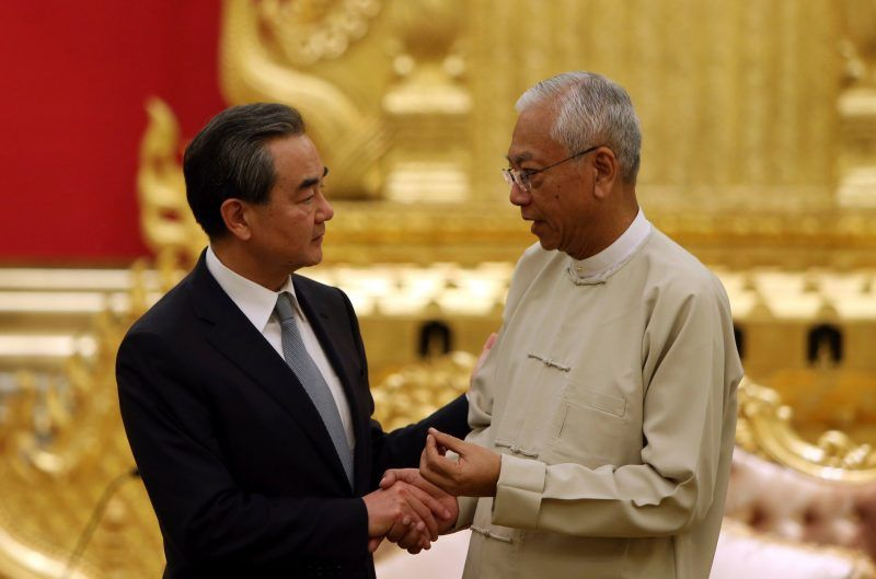 China's foreign minister, Wang Yi, left, meeting with President Htin Kyaw of Myanmar in the capital of Naypyitaw last month. Credit Aung Shine Oo/Associated Press