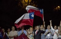 Supporters cheer as Sebastián Piñera, Chile's president-elect, and his wife Cecilia Morel, left, wave Chilean national flags at the National Renewal party headquarters after the second round presidential general elections in Santiago, Chile, on Dec. 17, 2017. (Cristobal Olivares/Bloomberg)