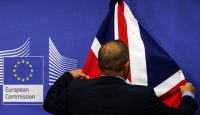 The union flag is arranged before Theresa May and Jean-Claude Juncker speak to reporters on 8 December. Photo: Getty Images