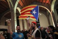 Pro-independence supporters celebrate at the ANC (Catalan National Assembly) headquarters after results of the regional elections Thursday in Barcelona. (Emilio Morenatti/AP)