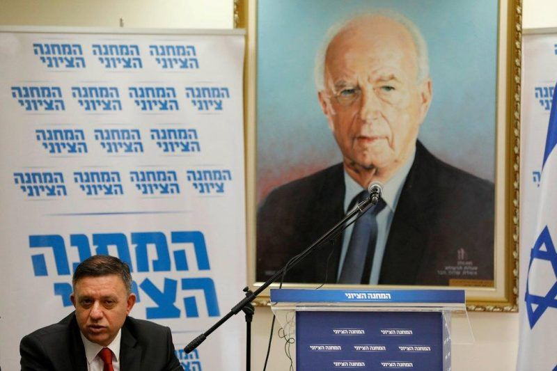 Avi Gabbay, leader of the Israeli Labor party, next to a painting of the former prime minister Yitzhak Rabin, in Jerusalem last month. Credit Abir Sultan/European Pressphoto Agency