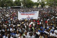 Youth supporters campaign for soccer legend Sen. George Weah, Liberian presidential candidate, during a rally in Monrovia, Liberia in August 2017. Weah and Joseph Boakai will face off in the final election round, now scheduled for Dec. 26. (Ahmed Jallanzo/EPA)