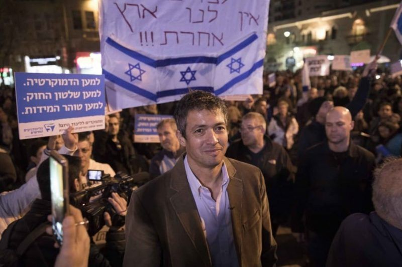 Rally organizer Yoaz Hendel, center, is shown during a protest against government corruption in Jerusalem on Dec. 23. (Abir Sultan/EPA-EFE/REX/Shutterstock