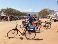 Bike taxi operators wait for work in Liwonde, Malawi, in August 2016. (Kim Yi Dionne/The Monkey Cage)