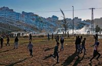 Palestinian protesters fleeing tear gas smoke in Ramallah on Friday. Credit Abbas Momani/Agence France-Presse — Getty Images