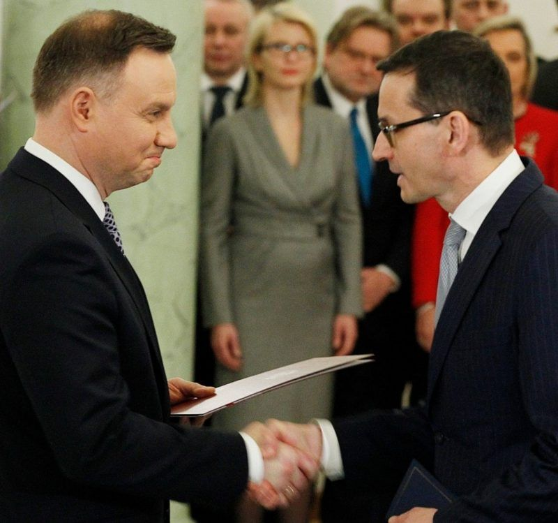 Poland's President Andrzej Duda, left, hands new Prime Minister Mateusz Morawiecki the document of his appointment as head of government at a ceremony at the Presidential Palace in Warsaw on Dec. 11. (Czarek Sokolowski/AP)