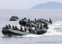 A North Korean military training exercise in August. Credit Korean Central News Agency, via Korea News Service, via Associated Press