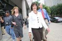 Cathy McBroom walking away from the Court House in Houston in May 2009, after the sentencing of U.S. District Judge Samuel Kent. Credit Mayra Beltran/Houston Chronicle, via Associated Press