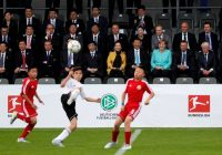 President Xi Jinping of China and his wife Peng Liyuan sit with Chancellor Angela Merkel of Germany and Reinhard Grindel, president of the German Football Association, at a children's soccer game between China and Germany. The match took place during Mr. Xi's visit to Olympic Park in Berlin, in July 2017. Credit Pool photo by Ronald Wittek