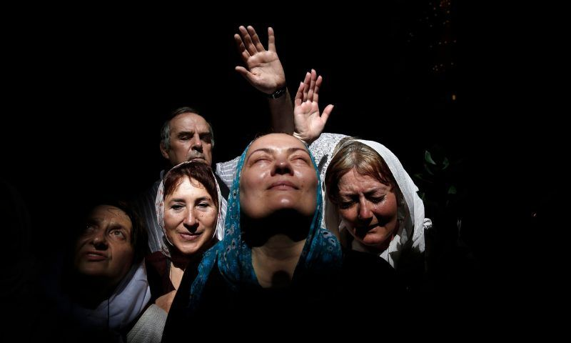 Orthodox Christians at the Holy Fire ceremony, at the Church of the Holy Sepulchre in Jerusalem's Old City. Photograph: Finbarr O'Reilly/Reuters