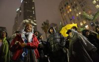 LOS ANGELES, CA - MARCH 1, 2015: Patrisse Cullors, cofounder of Black Lives Matters speaks to the people gathered at Pershing Square to protest a homeless man who was shot during a confrontation downtown by the LAPD, March 1, 2015 in Los Angeles, California.. Footage of the shooting went viral after police shot and killed an unarmed homeless man on skidrow. (Photo by Marcus Yam/ Los Angeles Times via Getty Images)