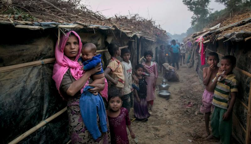 Makeshift shelters at the Kutapalong Rohingya refugee camp in Bangladesh. Poor living conditions makes the transmission of disease more likely. Photo by Allison Joyce/Getty Images.