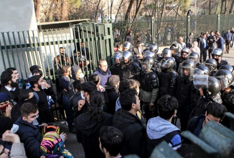 Iranian riot police prevent university students from joining other protesters in Tehran on Dec. 30, 2017. (AP)