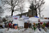 A memorial near the site of a fatal shooting at a Quebec City mosque in January 2017. (Mathieu Belanger/Reuters)