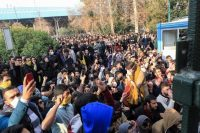 University students attend a protest inside Tehran University while anti-riot Iranian police prevent them from joining other protesters in Tehran on Dec. 30, 2017, in this photo taken by an individual not employed by the Associated Press and obtained by the AP outside Iran. (Associated Press)