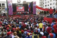 Attendees stand during a rally with Venezuelan President Nicolás Maduro in Caracas, Venezuela, on Tuesday. (Carlos Becerra/Bloomberg News)