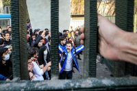 In this photo, by an individual not employed by the Associated Press and obtained by the AP outside Iran, students attend an anti-government protest Saturday inside Tehran University. (AP)