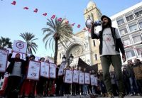 Family members of Tunisians who died in the revolution seven years ago stage a protest on Thursday in the capital, Tunis. (Hassene Dridi/AP)