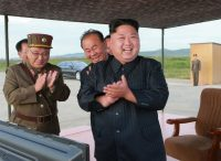 This undated photo distributed Sept. 16 by the North Korean government purports to show Kim Jong Un, right, celebrating what was said to be the test launch of an intermediate-range missile. (Korean Central News Agency/Korea News Service via AP)