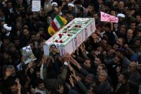 Pro-government supporters in the Iranian city of Najafabad march during the funeral of a young member of the Revolutionary Guard on Wednesday. (Morteza Salehi/Agence France-Presse/Getty)