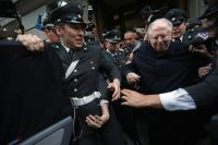 The Chilean priest Fernando Karadima being escorted from a court in Santiago, Chile, in 2015. Credit Luis Hidalgo/Associated Press