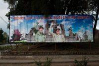 Un cartel en Holguín, Cuba, con Fidel y Raúl Castro Credit Andrea Bruce para The New York Times