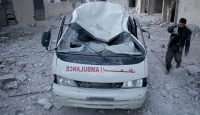 A damaged ambulance in front of Arbin Hospital in eastern Ghouta after an airstrike. Photo: Getty Images.