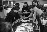 Moises Saman/Magnum Photos. Young refugees baking Christmas cookies with Swedish volunteers at a transit center for unaccompanied asylum seekers in Malmö, Sweden, 2015