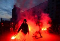 Demonstrators march with flares during a demonstration against fascism in Milan. (Massimo Pinca/Reuters)