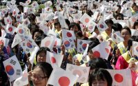 Members of the Unification Church commemorate the Korean Peninsula's liberation from Japanese colonial rule, in Seoul in 2012. Credit Ahn Young-joon/Associated Press
