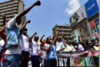 "On Monday, civil rights activists in Nairobi protest the government shutdown of Kenyan television stations. The channels were blocked from broadcasting a ""swearing-in"" of opposition leader Raila Odinga. (Tony Karumba/AFP/Getty Images)"