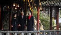 Theresa May and her husband Philip visit the Yu Yuan Temple Gardens in Shanghai. Photo: Getty Images.