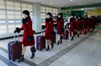 North Korean cheering squads arriving at the Korean-transit office near the Demilitarized Zone in Paju, South Korea, this week. Credit Pool photo by Ahn Young-Joon
