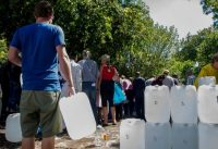 "People line up for water at a natural spring in Cape Town, South Africa, on Jan. 23 after the drought-stricken city tightened water restrictions in a bid to avoid what it calls ""Day Zero,"" the day in mid-April when it might have to turn off most taps. (Associated Press)"
