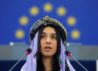 Nadia Murad addressing the European Parliament in 2016. Credit Vincent Kessler/Reuters