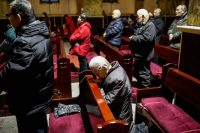 Chinese Catholics pray at a morning Mass in the Xuanwumen Catholic Church in Beijing on Jan. 30 (Roman Pilipey/EPA-EFE/Shutterstock)