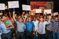 Opposition supporters shout slogans during a protest in Male, Maldives, on Feb. 4. (Mohamed Sharuhaan/AP)