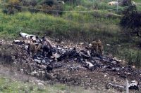 Remains of an Israeli F-16 fighter jet that crashed in northern Israel on Saturday, after coming under antiaircraft fire. Credit Abir Sultan/European Pressphoto Agency