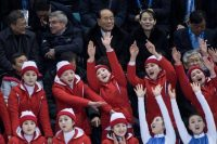 Seated behind North Korea's cheerleaders at the Olympics are, from left, Moon Jae-in, South Korea's president; Thomas Bach, president of the International Olympic Committee; Kim Yong Nam, president of the Presidium of the Supreme People's Assembly of North Korea; and Kim Yo Jong, the sister of Kim Jong Un. (AFP/Getty Images)