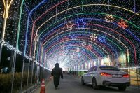 A visitor passes under LED light decorations ahead of the 2018 PyeongChang Winter Olympic Games in Gangwon Province, South Korea, on Thursday. (Bloomberg News)