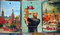 "A picture taken on July 5, 2017 shows a souvenir kiosk offering among others a drawing depicting Russian President Vladimir Putin holding a baby with the face of US President Donald Trump, based upon a propaganda poster showing late soviet leader Joseph Stalin holding a baby, in Moscow. It was a constant refrain on the campaign trail for Donald Trump in his quest for the US presidency: ""We're going to have a great relationship with Putin and Russia."" Now, weighed down by claims that Moscow helped put him in the White House, Trump is set to finally meet his Russian counterpart in an encounter fraught with potential danger for the struggling American leader. / AFP PHOTO / Mladen ANTONOV (Photo credit should read MLADEN ANTONOV/AFP/Getty Images)"