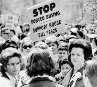 Louise Day Hicks, lower right, a leader of the movement against busing to achieve desegregation in public schools, at a protest in Boston in 1973. Credit Bettmann/Getty Images