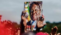 Supporters hold up a poster of Morgan Tsvangirai during a memorial service in Harare. Photo: Getty Images.