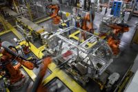 Robotic systems assemble a car at the Jaguar Land Rover factory in Solihull, England. March 1, 2017. (Leon Neal/Getty)