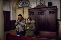 Catholics praying in Beijing on Jan. 30, two days before new repressive regulations of religion went into force in China. Credit Roman Pilipey/European Pressphoto Agency