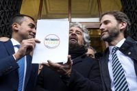 Luigi Di Maio (L), Beppe Grillo (C) and Davide Casaleggio (R) pose in front of the Italian Interior Ministry after presenting the new symbol of the Five Star Movement for the March general election. Jan. 19, 2018 in Rome, Italy. (Angelo Carconi/EPA-EFE/REX/Shutterstock)