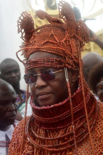 Oba Ewuare II, traditional ruler of the kingdom of Benin, at his coronation in 2016. This month he issued one curse and revoked others in a bid to encourage victims to testify against human traffickers. Credit Pius Utomi Ekpei/Agence France-Presse — Getty Images